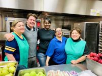 Cafeteria Staff ready to serve children