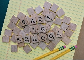 Back to School spelled with scrabble tiles